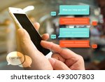 Small photo of Chat bot and future marketing concept , Chatbot icon , Hand holding mobile phone with automatic message screen with abstract background