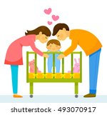 mother and father kissing their ... | Shutterstock .eps vector #493070917