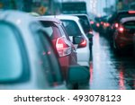 Small photo of traffic congestion asia in dusk with rainy day