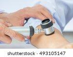 dermatologist examines child... | Shutterstock . vector #493105147