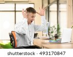 emotional man with laptop in... | Shutterstock . vector #493170847