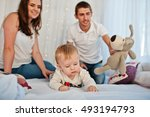 mother and father with baby boy ... | Shutterstock . vector #493194793