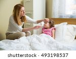 worried mother giving glass of... | Shutterstock . vector #493198537