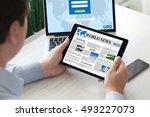 man holding tablet computer... | Shutterstock . vector #493227073