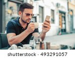 young businessman sitting in a... | Shutterstock . vector #493291057