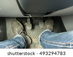 Small photo of foot pressing the accelerate pedal of a car