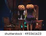 Children Holding Pumpkins In...