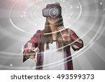 woman using virtual reality...