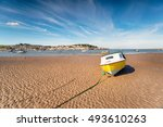 A Yellow Boat At Low Tide On...