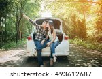 couple on road trip sit on... | Shutterstock . vector #493612687
