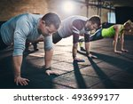 group of adults performing push ... | Shutterstock . vector #493699177