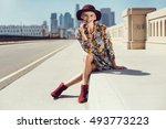 fashionable woman in a hat ... | Shutterstock . vector #493773223