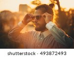 young guy hipster on the street | Shutterstock . vector #493872493