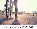 woman ride bike on the summer... | Shutterstock . vector #493971847