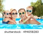 Happy Family In Swimming Pool...