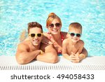 happy family in swimming pool... | Shutterstock . vector #494058433