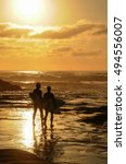 surfer couple in silhouette... | Shutterstock . vector #494556007