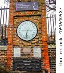 Small photo of GREENWICH, LONDON, FEBRUARY 19, 2015: The Shepherd gate 24-hour clock , outside the observatory gate of Royal Greenwich Observatory is an early example of an electric slave clock.