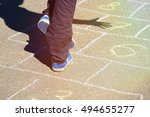 kid playing hopscotch on... | Shutterstock . vector #494655277