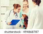 Stock photo medicine pet care and people concept happy woman holding dachshund dog and veterinarian doctor 494868787