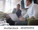 two young man sitting in office ... | Shutterstock . vector #494995993