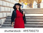 young stylish woman wearing red ... | Shutterstock . vector #495700273