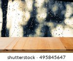 wood table top on rain drops on