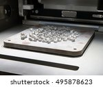 Small photo of Metal 3D printers (DMLS). Direct metal laser sintering (DMLS) is an additive manufacturing technique that uses a Ytterbium fibre laser fired into a bed of powdered metal.