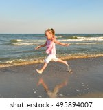 Small photo of Little sweet girl runs along the beach and have fun/Little sweet girl runs along the beach and have fun. Black sea, Ukraine/Little sweet girl runs along the beach and have fun