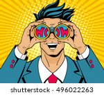 Wow pop art man. Young surprised man in suit with open smile holding binoculars in his hands with inscription wow in reflection. Vector illustration in retro comic style. Colorful pop art background. | Shutterstock vector #496022263