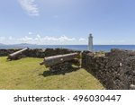 old cannons and lighthouse at... | Shutterstock . vector #496030447