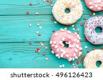 donuts on colorful wooden... | Shutterstock . vector #496126423