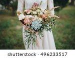 bride in a dress standing in a... | Shutterstock . vector #496233517