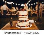 three level white wedding cake... | Shutterstock . vector #496248223