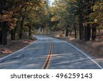 mountain road with fall colors   Shutterstock . vector #496259143