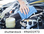 wipe cleaning the car engine... | Shutterstock . vector #496431973