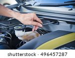 man check the car engine  check ... | Shutterstock . vector #496457287