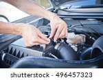 man check the car engine  check ... | Shutterstock . vector #496457323