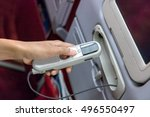 remote control in hand on board ... | Shutterstock . vector #496550497