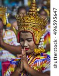 Small photo of Trang, Thailand - October 28, 2015 ; Young Thai gird wearing traditional clothing during Awx Phansa, push boat buddha festival in Trang, Thailand