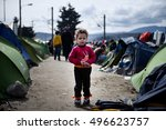 Small photo of Idomeni, Greece - March 8, 2016. A Syrian boy stands outside his tent, as around 10000 refugees and migrants remain stranded at the Greek Macedonian border, at the makeshift refugee camp of Idomeni.