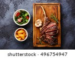 sliced grilled steak on bone... | Shutterstock . vector #496754947