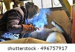 woman welder welding with mig... | Shutterstock . vector #496757917