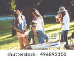 cheerful friends on picnic in... | Shutterstock . vector #496893103