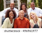 Small photo of Diverse group of friends. Multicultural people smiling. Friends smiling and laughing.