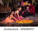 indian young family arranging... | Shutterstock . vector #496984957