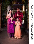 cheerful indian family... | Shutterstock . vector #496988497