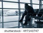sad man waiting for delayed... | Shutterstock . vector #497143747