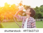 man drinking water from bottle... | Shutterstock . vector #497363713