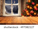 wooden table and xmas tree in... | Shutterstock . vector #497382127